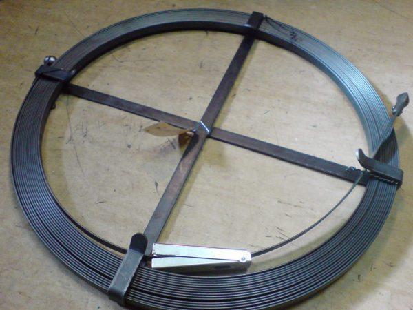 Стальная лента для прочистки канализации большого диаметра.